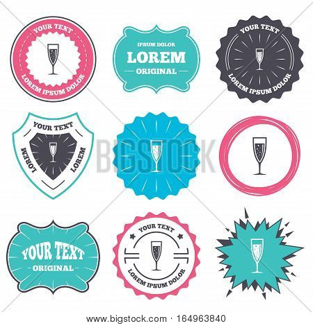 Label and badge templates. Glass of champagne sign icon. Sparkling wine with bubbles. Celebration or banquet alcohol drink symbol. Retro style banners, emblems. Vector