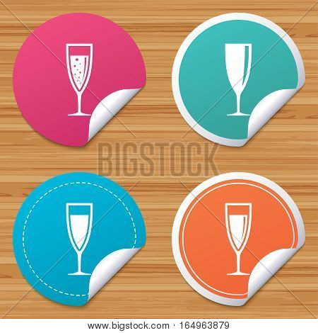 Round stickers or website banners. Champagne wine glasses icons. Alcohol drinks sign symbols. Sparkling wine with bubbles. Circle badges with bended corner. Vector