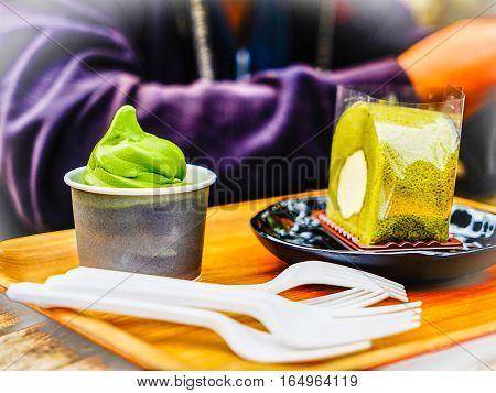 Green tea roll cake and green tea ice cream in green tea shop at Osulloc tea museum Jeju island South Korea.