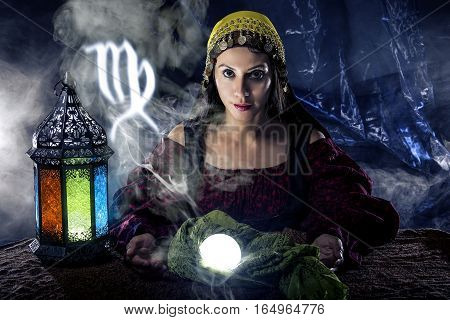 Psychic or fortune teller with crystal ball and horoscope zodiac sign of Virgo