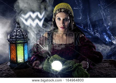 Psychic or fortune teller with crystal ball and horoscope zodiac sign of Aquarius