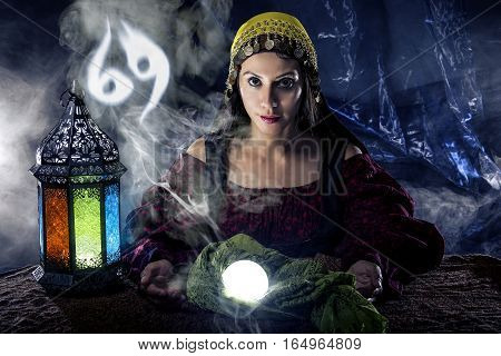 Psychic or fortune teller with crystal ball and horoscope zodiac sign of cancer