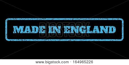Light Blue rubber seal stamp with Made In England text. Vector tag inside rounded rectangular shape. Grunge design and dirty texture for watermark labels. Horisontal sticker on a black background.