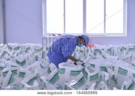 Bac Giang Vietnam - November 30 2015: Worker are packaging to produce agar product in a factory