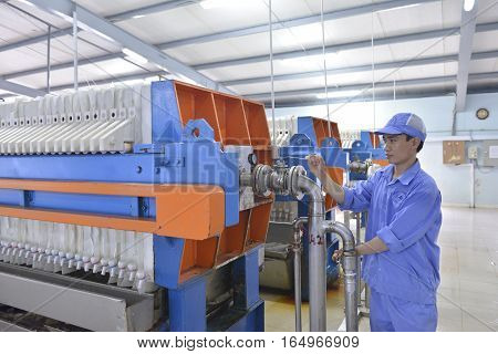 Bac Giang Vietnam - November 30 2015: Worker are controling machine in an agar factory