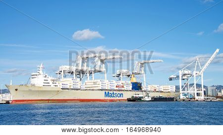 Oakland CA - January 01 2017: Matson cargo ship MANOA loading at the Port of Oakland. Matson provides shipping services Pacific wide. Mainly to and from the Hawaiian Islands.