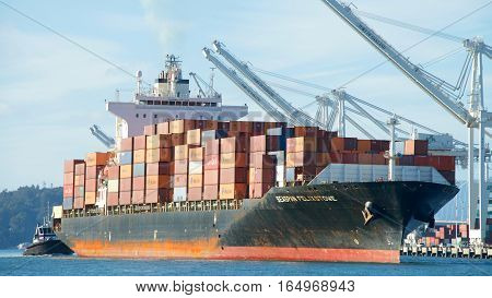 Oakland CA - January 01 2017: Cargo ship SEASPAN FELIXSTOWE entering the Port of Oakland the fifth busiest port in the United States.