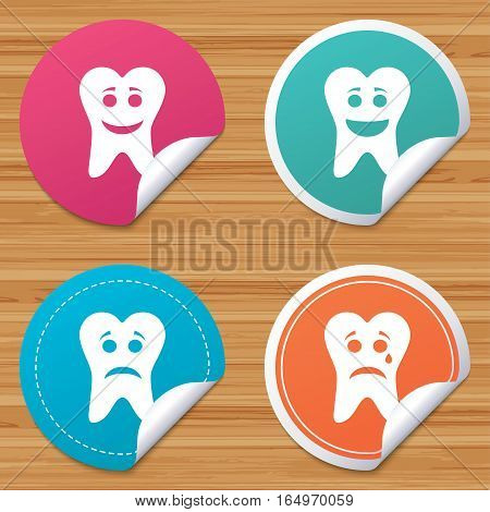 Round stickers or website banners. Tooth happy, sad and crying faces icons. Dental care signs. Healthy or unhealthy teeth symbols. Circle badges with bended corner. Vector