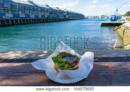 Australian Traditional Meat Pie With Woolloomooloo Bay On The Background