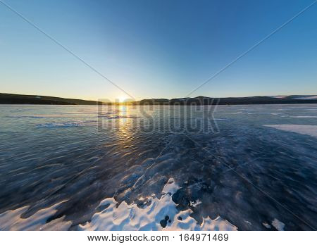 Sunrise On The Island Of Olkhon, Snowy Spot On The Ice Of Lake Baikal