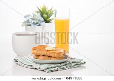 Toast and butter served with fresh coffee and orange juice.