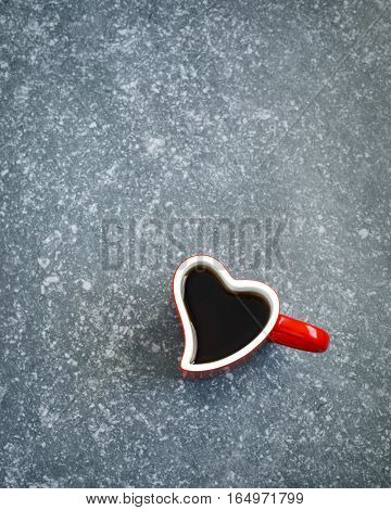 Heart shaped cup of tea. Valentines day concept. Top view