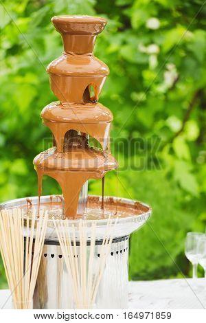 Chocolate. Chocolate fountain. Chocolate sauce. Chocolate fondue. Sweet food concept. Dessert