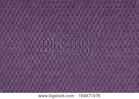 Dark violet background from soft fleecy fabric closeup. Texture of textile macro.