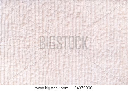 White pearl vfluffy background of soft fleecy cloth. Texture of textile closeup.