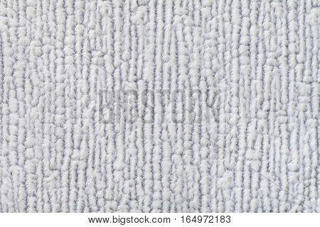 Light gray fluffy background of soft fleecy cloth. Texture of textile closeup