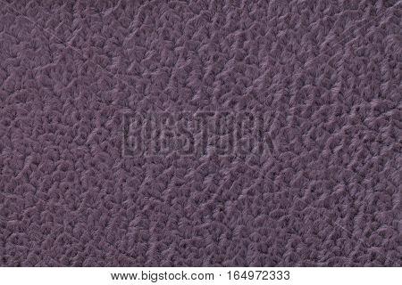 Dark purple fluffy background of soft fleecy cloth. Texture of textile closeup.