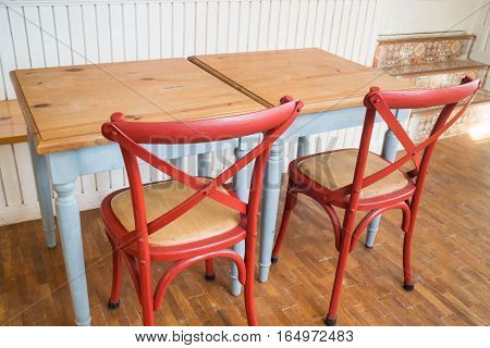Vintage wooden kitchen table and chair stock photo