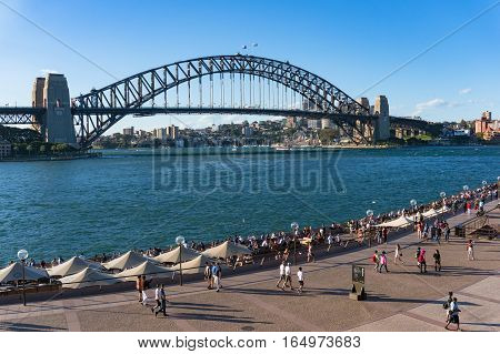 Circular Quay Waterfront With View Of Sydney Harbour Bridge