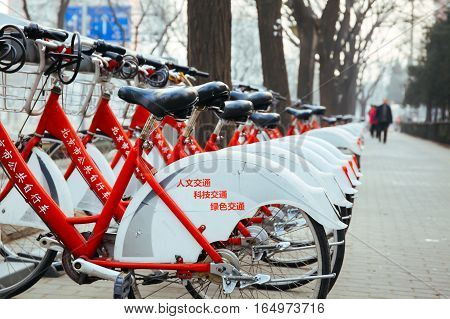 Beijing,china 6 January 2017: Public Bike Rental Station In Beijing, China With Bicycles Arranging I