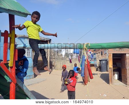 SWAKOPMUND, NAMIBIA OCTOBER 09, 2014: Unidentified children living in Mondesa slum of Swakopmund on october 09 2014. In Namibia About 27.6 per cent of households are classified as poor.