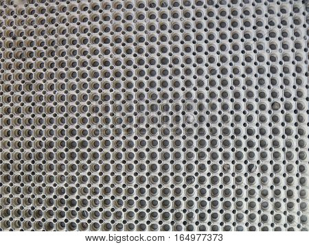 Closeup of large clean rubber door mat