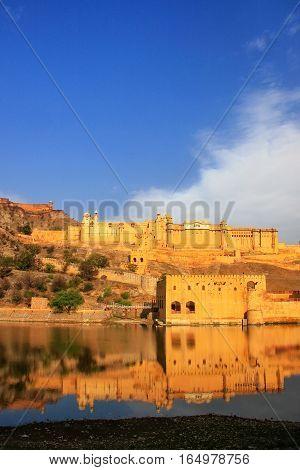 Amber Fort Reflected In Maota Lake Near Jaipur, Rajasthan, India.