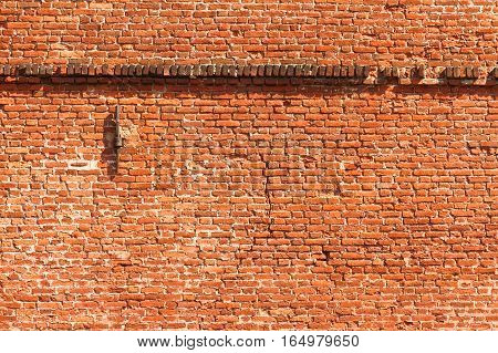 A fragment of an old factory brick wall. Texture background