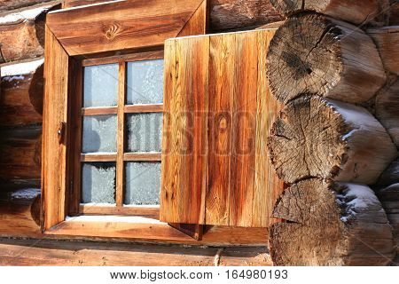 Wooden shutters in a house made of logs. Traditional Russian wooden architecture in Siberia. View winter. Taltsy. Irkutsk. Russia.