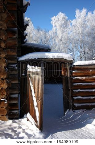 gate. Traditional Russian wooden architecture in Siberia. View winter. Taltsy. Irkutsk. Russia.