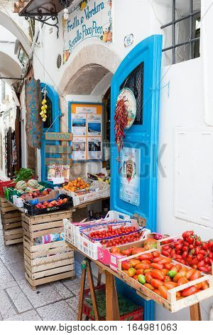SPERLONGA LAZIO ITALY - MAY 30 2016: Frutta E Verdura Sorelle Poco Poco old typical fruits and vegetables shop in the old historical part of the village selling fresh mediterranean products.