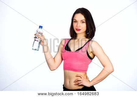 Young Woman In Sportswear With A Bottle Of Drinking Water