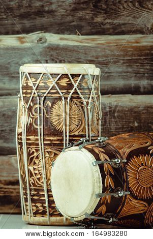 variation of beautiful ethnic indian drums dholak on wooden background