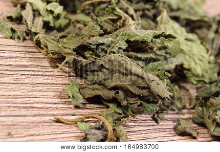 Heap Of Dried Nettle On Wooden Surface