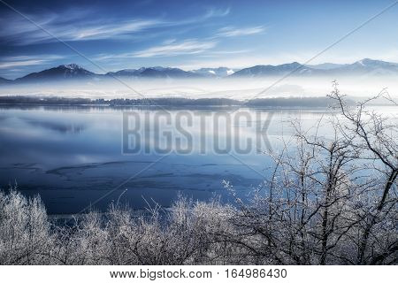 Lake Liptovska Mara Slovakia covered in ice.on a quiet winter days. Backround of Low Tatras mountains Slovakia. Beautiful landscape