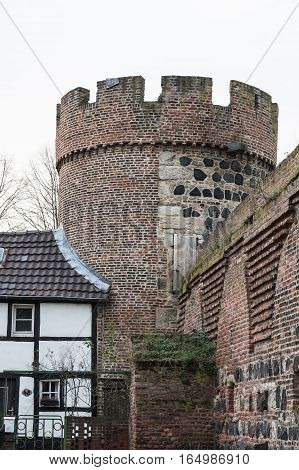 The Kroetschenturm with ramparts in the town Zons am Rhein Germany.