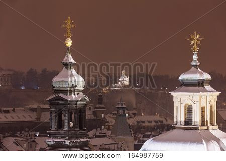 Winter snowy Prague. View of the snowy towers of the cathedral in the old town. In the distance you can see Hanavsky pavilion Czech Republic
