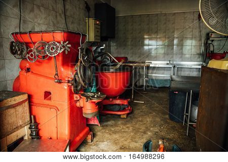 workshop for the production of sausages. big red chopper.