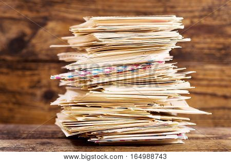 stack of envelopes on a wooden background