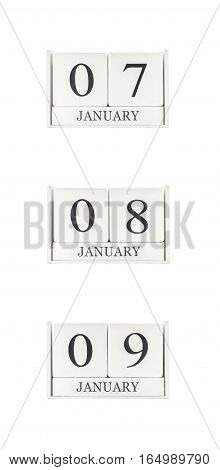 Closeup group of white wooden calendar with black 7 8 9 january word three date calendar isolated on white background