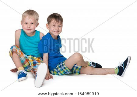Two Little Boys Sit Together