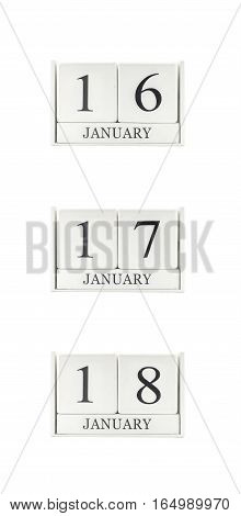 Closeup group of white wooden calendar with black 16 17 18 january word three date calendar isolated on white background