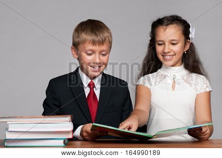 Boy And Girl At The Desk With Books