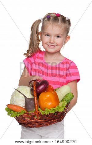 Little Girl With A Basket With Vegetables