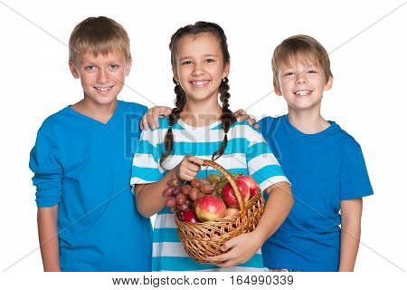 Kids Hold A Basket With Vegetables