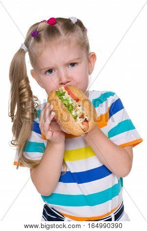 Little Girl Eats Hot Dog