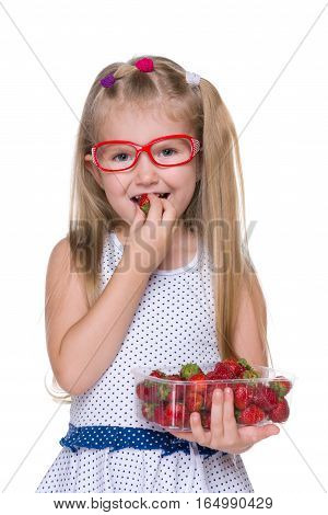 Little Girl Eats Strawberry