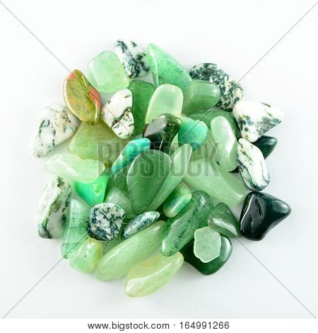Closeup green stones isolated on white background