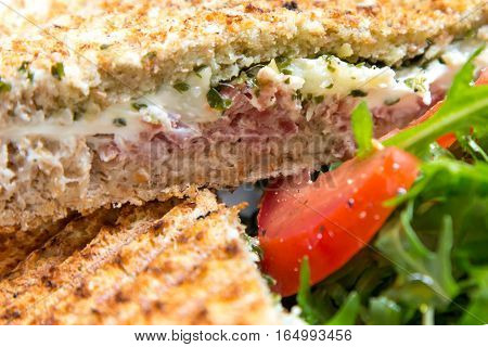 Healthy eating, dieting and cooking concept,  close up of sandwich with whole-grain bread, tomatoes, green leafs