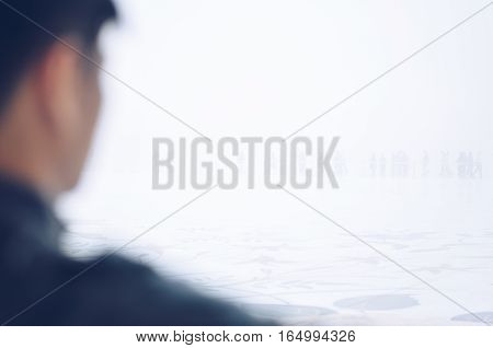 Close-up image of a man looking through a fog